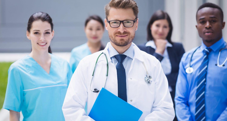 Portrait of smiling doctors standing together in hospital premises